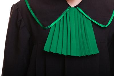 Law justice. Closeup lawyer attorney classic polish black green gown